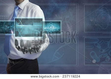 Man with 3D robot hand interacting with medical interfaces