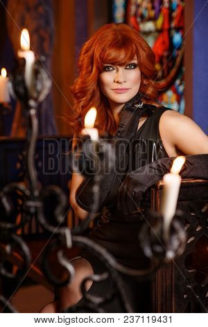 Beautiful Girl Dressed In Gothic Style In Castle Interior