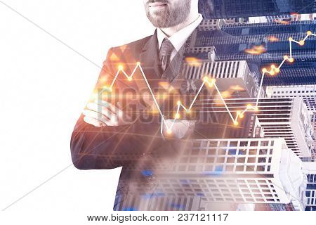 Businessman With Abstract Glowing Forex Chart On Blurry City Background With Copy Space. Fund Manage