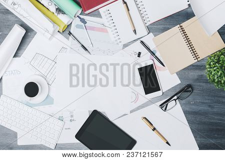 Blank Touchpad And Smartphone Place On Modern Office Desk Top With Supplies And Other Items. Mock Up