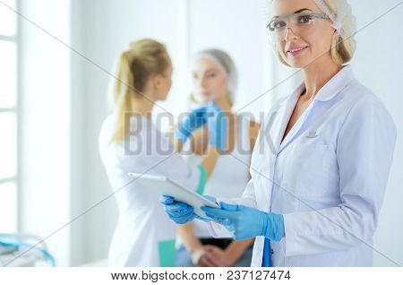 Beautiful woman face near doctor with syringe.