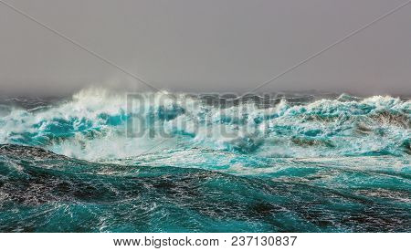 The Southern Arctic Circle. Atlantic Ocean. Storm. Large waves with sharp gusts of wind.