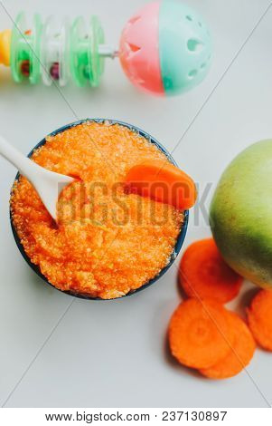 Baby Food Carrot Puree With Green Apples In Ceramic Bowl On White Background