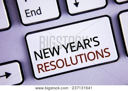Handwriting Text Writing New Year's Resolutions. Concept Meaning Goals Objectives Targets Decisions
