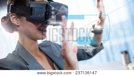 Digital composite of Digital composite image of businesswoman touching futuristic screen while using VR glasses
