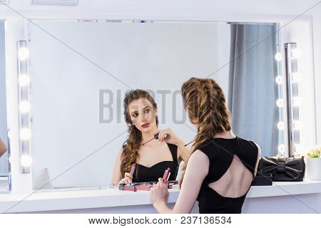 Beautiful Sexy Blonde Girl Sitting At The Table Make-up Artist Near The Mirror, Applied The Lipstick
