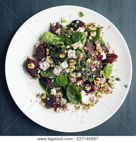 Beetroot Salad With Cottage Cheese, Baby Spinach And Walnuts. European Cuisine. Organic Food. Vegeta