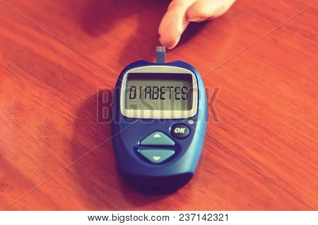 Diabetes Concept With Diabetes Medication On Wooden Desk. Inscription Diabetes On The Meter. High Bl