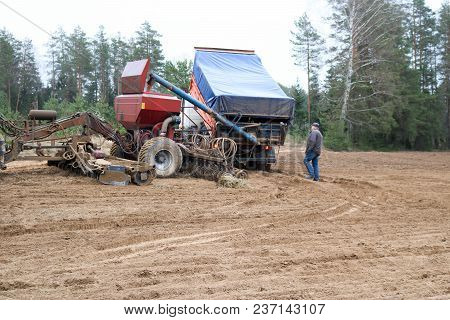 Sowing Unit, Combine Harvester, Seeder And Lorry, Dumper On The Field.