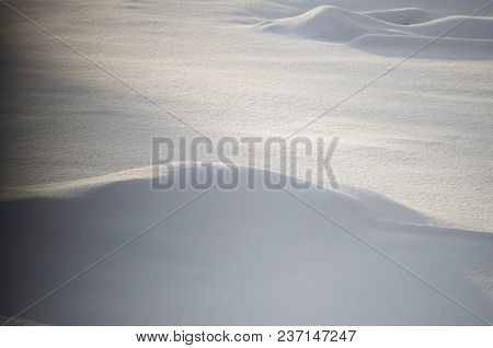 Layers Of Snow Piled In This Desolate Landscape