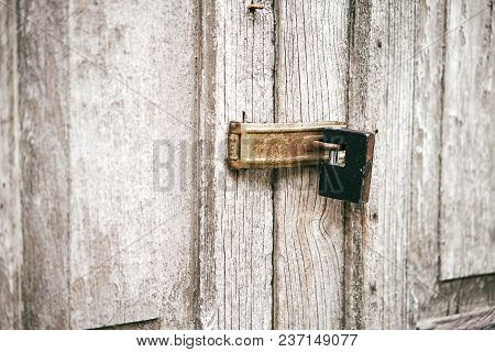 The Old White Door With Stained Locked With The Black Key On Hinge