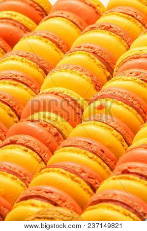 Traditional French Colorful Yellow And Pink Macarons In A Rows