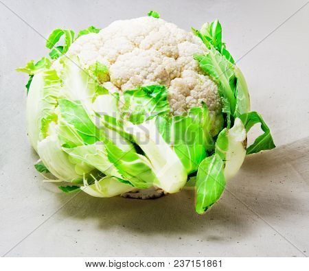 White Cauliflower With Green Leaves On A Clear Background-  Brassica Oleracea,  Botrytis