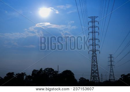 High-voltage Pylons In Bright Weather. The Concept Of Electric Power Transport
