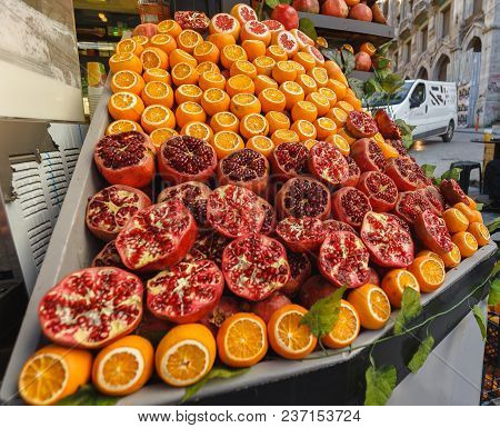 Apples Oranges And Grenades Colorful Fresh Fruit Market On Istanbul Streets. A Lot Of Fruits .