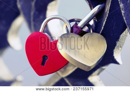 Two Locks In The Shape Of A Heart Hanging.