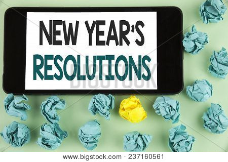 Conceptual Hand Writing Showing New Year's Resolutions. Business Photo Text Goals Objectives Targets