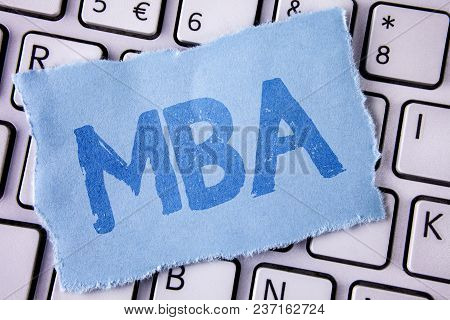 Word writing text Mba. Business concept for Master of Business Administration Advance Degree After College Studies written Tear Sticky note paper piece placed White Keyboard. Top View. poster