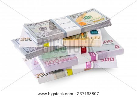 Pile Of Money - Dollar And Euro Banknotes On White.