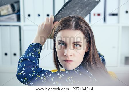 Girl In Office With Folder Anger Trying To Hit His Colleague.