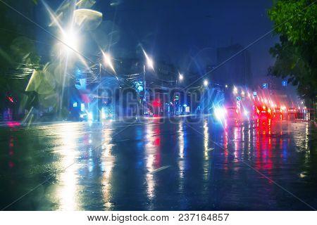 Car Goes At Night On The Rainy City