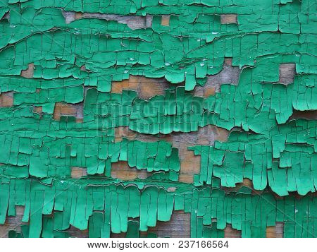 The Old Green Paint Cracked And Peeled Off Revealing The Ancient Boards