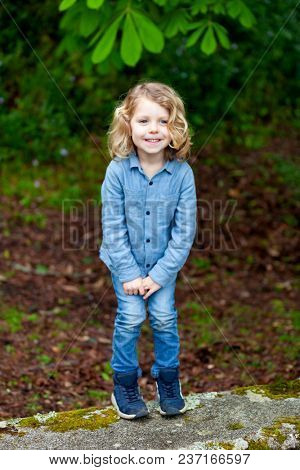 Child in the field wanting to pee