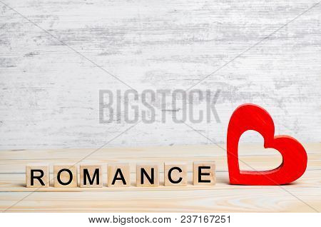 Romance, The Concept Of Love, A Wooden Red Heart And A Romance Inscription. I Love You. Place For Te