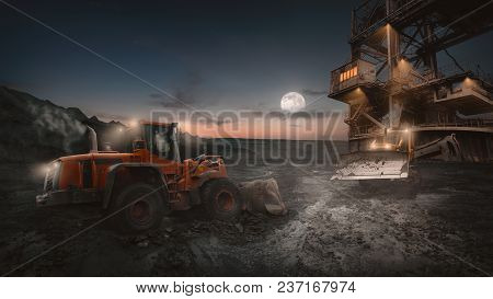 Heavy Equipment Vehicles Of Various Types - Wheeled Bulldozer -  In Night Shift Work On A Constructi