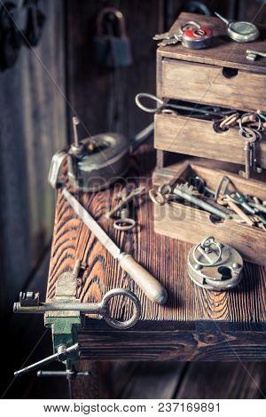 Vintage Locksmiths Table Full Of Keys And Locks