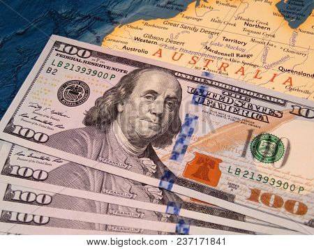 Us Dollars On The Map Of Australia. American Investment In The Australian Economy