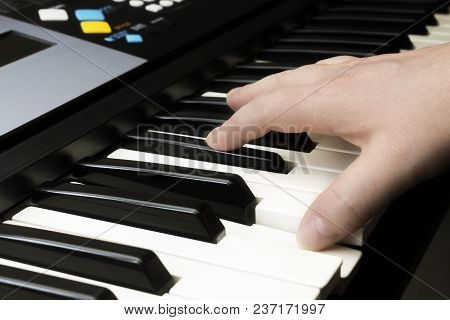 Midi Keyboard Synthesizer Piano Keys. A Music Instrument Background, Music Concept. A Photo Of A Cau
