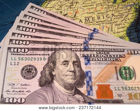 Us Dollars On The Map Of United States. American Economy Concept