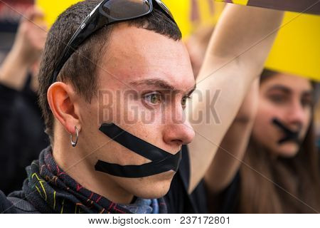 Valencia, Spain: April 21, 2018 - A Closeup Of A Young Man With A Black X Taped Across His Mouth Mar