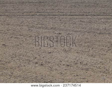 Texture Of The Land Plowed By A Plow Field