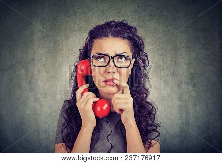 Worried Perplexed Woman On The Phone Listening To Bad News