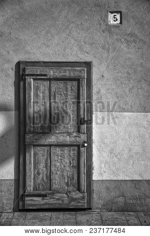 Ancient Door In Monochrome, Cracked Wooden Entrance, Sample For Post Card.