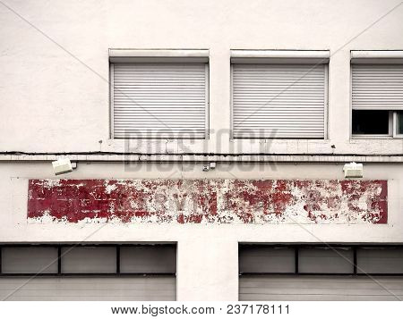 Laconic Geometric Old Facade With A Shabby Red Color