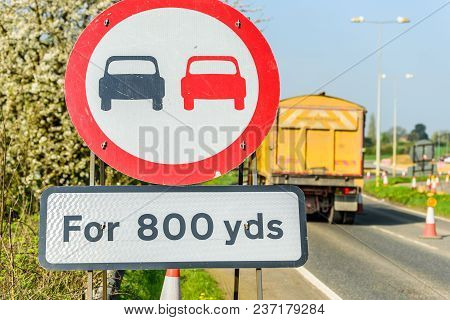 No Overtaking 800 Yards Zone Sign On Uk Motorway With Lorry On Background.