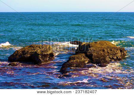 Waves Crashing Onto Rocks Taken In The Rugged California Coast