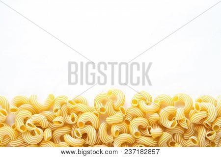 Raw Cavatappi Beautiful Decomposed Pasta With A Bottom On A White Isolated Background. Close-up View