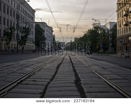 City Landscape. Tram Rail Stretching Into The Distance. A Street With An Unevenly Laid Old Tile. Sum