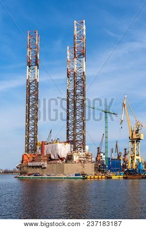 Oil Rig Docked In Shipyard Of Gdansk. Poland