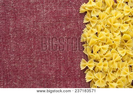 Farfalle Raw Farfallini Beautiful Decomposed Pasta With The Right, On Its Side On A Rustic Red-brown