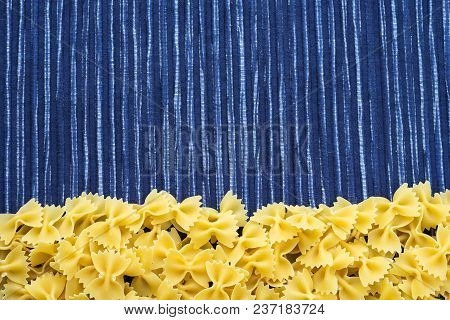 Farfalle Raw Farfallini Beautiful Decomposed Pasta With A Bottom On A Rustic Striped Blue White Text