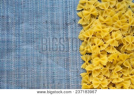 Farfalle Raw Farfallini Beautiful Decomposed Pasta With The Right, On Its Side On A Rustic Blue Knit