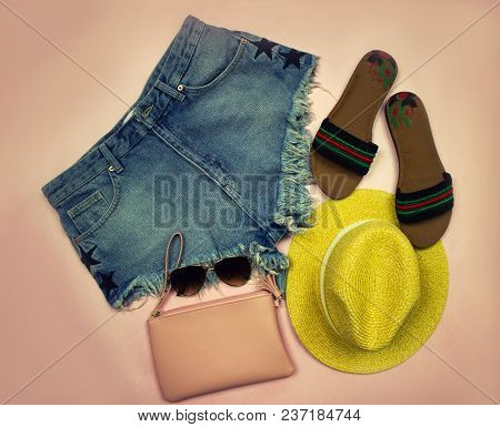 Subject Photography. Summer Set Of Clothes On A Pink Background Consisting Of Denim Shorts, Yellow H
