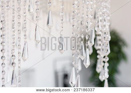 Contemporary Crystal Chandelier In Room Interior. Close Up.