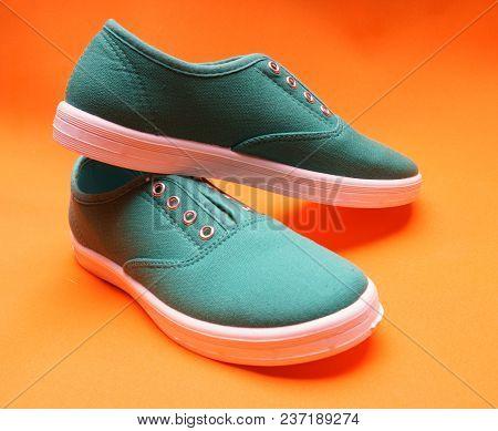 Stylish Green Sneakers On Orange Background, Minimal Fashion Style, Fitness Shoes