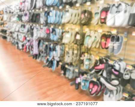Blurred Shoes Hanging On Display At Discount Retail Store In Usa